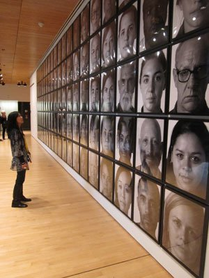 Standing in front of faces at SF Museum of Modern Art.